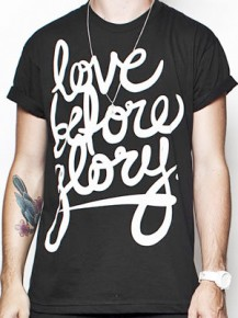 Picture of black T-shirt with the text: Love before glory