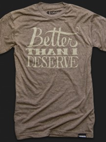 Picture of brown T-shirt with typographic print (the text: better than I deserve)